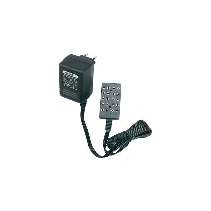 Transfo 5,6VA, avec 2 fiches femelle 5 sorties pour 5 ampoules de 3V5 et clignotantes 1VA